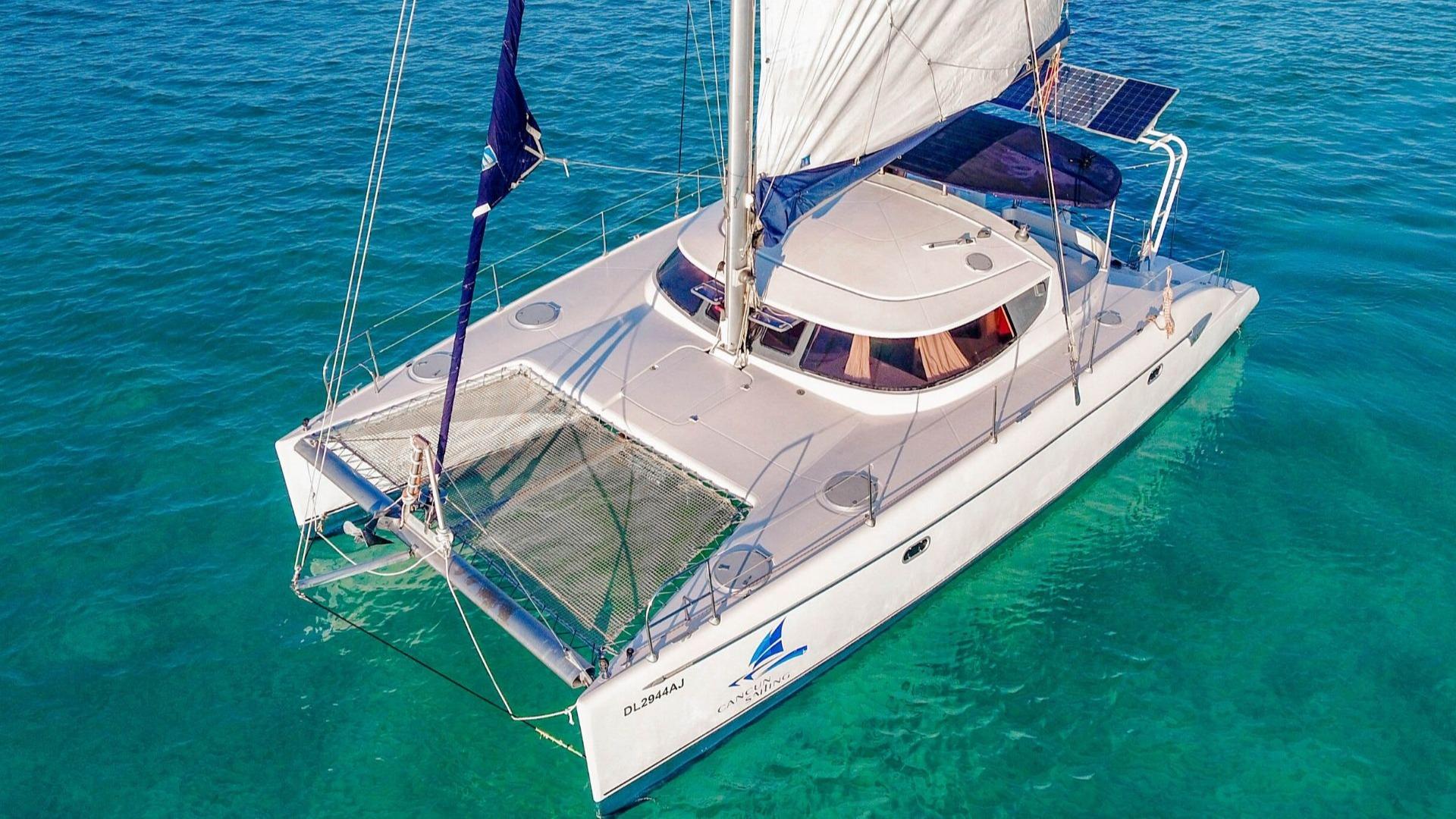 2 - LowRes - Mango - Isla Mujeres Catamaran Tour - Cancun Sailing